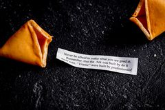 Chinese fortune cookie with prediction on dark background top vi. Chinese fortune cookie with prediction on dark background close up top view stock images