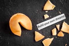 Chinese fortune cookie with prediction on dark background top view Royalty Free Stock Image