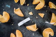 Chinese fortune cookie. With prediction on dark blue concrete background copy space stock photo