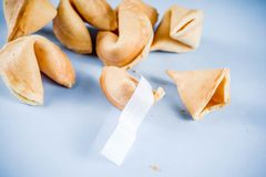 Chinese fortune cookie. With prediction on light blue background top view copy space stock photo