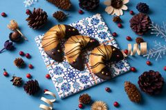 Chinese fortune cookies. Delicious traditional Fortune cookies on a blue background with Christmas decorations, close-up Stock Photography