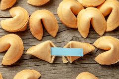 Chinese fortune cookies. Cookies with empty blank inside for prediction words. Background of old wooden table. Chinese fortune cookies. Cookies with empty blank stock image