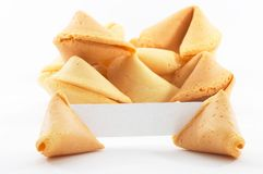 Chinese fortune cookies with white blank paper. Chinese fortune cookies, on white background, with a white piece of paper for entering own text/fortune Stock Images