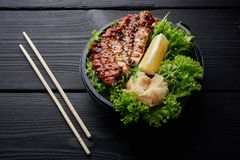 Chinese fried chiken on salad with lemon and ginger stock photo
