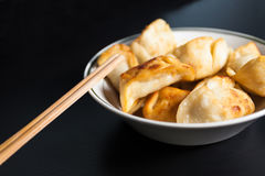 Chinese fried dumplings. Fried North homemade food, and the main ingredients are flour and meat, made ​​into dumplings oil Jianzhi made​​. Surface crisp Stock Photo