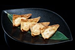 Chinese fried dumplings on a black plate Royalty Free Stock Images