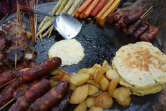 Chinese fried foods. Potatoes pie egg cured meat cured sausage stock photos