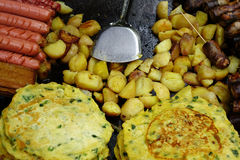 Chinese fried foods. Potatoes, pie egg, cured meat , cured sausage stock photo