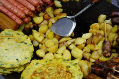 Chinese fried foods. Potatoes, pie egg, cured meat , cured sausage stock images
