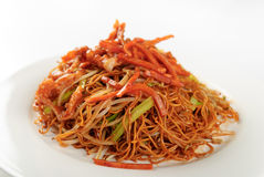 Chinese fried noodles. Classic fresh chinese fried noodles with pork and vegetables and coriander on top Stock Photography