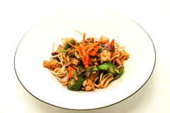 The Chinese fried noodles with squids, an octopus and vegetables. Royalty Free Stock Photo