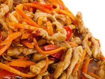 Chinese fried pork meat. With pepper and carrot Royalty Free Stock Photo
