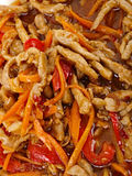 Chinese fried pork meat. With pepper and carrot Stock Photography