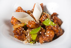 Chinese fried pork meat. Served on a white plate Stock Photography