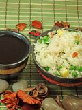 Chinese fried rice. A bowl of fried rice with vegetables and soya sauce Royalty Free Stock Image