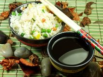 Chinese fried rice. A bowl of fried rice with vegetables and soya sauce Royalty Free Stock Photo
