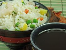 Chinese fried rice. A bowl of fried rice whit vegetables and soya sauce Royalty Free Stock Photos