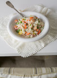 Chinese fried rice, with eggs, vegetables and spice on white tab Royalty Free Stock Images