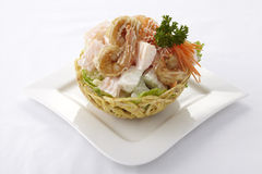 Chinese fruit salad in crispy taro basket Royalty Free Stock Photography