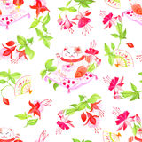 Chinese fuchsia and lucky cats sitting on the pillows Stock Images