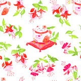 Chinese fuchsia and lucky cats sitting on the pillows Stock Image