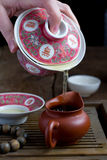 A chinese gaiwan with tea on a tea table Royalty Free Stock Photo