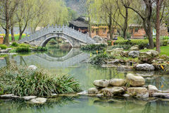 Chinese Garden with ancient stone bridge Stock Image