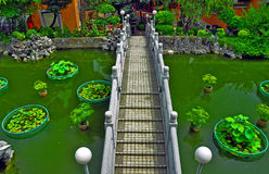 Chinese garden with footbridge Stock Photography