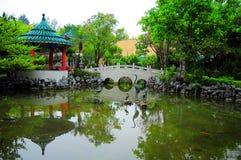 Chinese garden with footbridge royalty free stock photos
