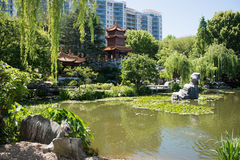 Chinese Garden of Friendship Scene. SYDNEY,NSW,AUSTRALIA-NOVEMBER 18,2016: Chinese garden of Friendship scene with lush greenery, outdoor architecture, tourists Royalty Free Stock Photo