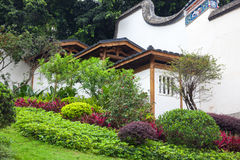 Chinese garden with hillside traditional building. Stock Images