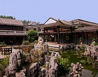 Chinese garden and pavilions inside a Chinese restaurant in Guan stock photo