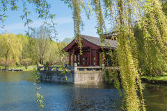 Chinese Garden of the Reclaimed Moon. Lake with tea house Royalty Free Stock Photo
