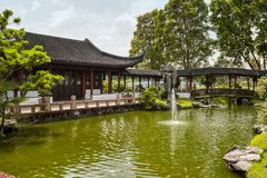Chinese garden in Singapore. Pond with a fountain and goldfish in the Chinese garden, Singapore Royalty Free Stock Photos