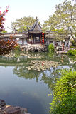 Chinese garden in Suzhou. Chinese garden with a beautiful lake in Suzhou, China Royalty Free Stock Image