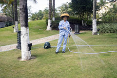 Chinese garden watering hose. China, Hainan island,the hotel Four Points Sheraton royalty free stock images