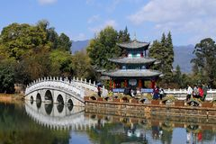 Chinese gardens in Lijiang. Black Dragon Pool in Jade Spring Park, Lijiang, Yunnan, China. It was built in 1737 during the Qing dy stock photos