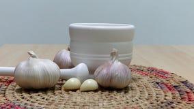 Chinese garlic and a garlic punch. Chinese garlic, garlic cloves and a garlic punch Stock Photography