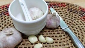 Chinese garlic and a garlic punch. Royalty Free Stock Images