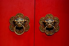Chinese gate. The dragon handle of a chinese gate Stock Image