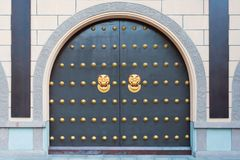 Chinese gate with golden colored door knockers. China royalty free stock image