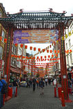 Chinese Gate. London - September 13: view of gate entrance into Chinatown in London, UK on September 13, 2014. The area around Gerrard Street contains many Royalty Free Stock Photography