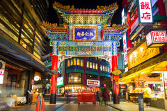Chinese gate to the in Chinatown district of Yokohama. YOKOHAMA, JAPAN - NOVEMBER 7, 2016 : Chinese gate to the in Chinatown district of Yokohama at night, Japan Royalty Free Stock Photo