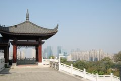 Chinese gazebo with Foshan panorama. A traditional Chinese wooden gazebo in a park with Foshan cityscape in the background Royalty Free Stock Photo