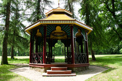 Chinese gazebo in the woods. Chinese wooden gazebo in the pine forest Stock Photo