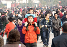 Chinese get toghther. Many Chinese  get together in a square to celebrate the lantern festival ,a boy sit on the shoulder of his father ,taken on  February 17 Royalty Free Stock Image