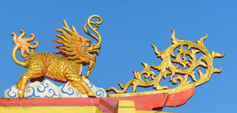 Chinese Ghilen on the shrine roof. Chinese Ghilen on the shrine roof,blue sky background stock images