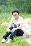 Chinese girl. A beautiful chinese girl relaxing outdoors Royalty Free Stock Images