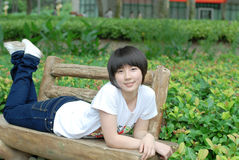 Chinese girl. A beautiful chinese girl relaxing outdoors Stock Photos