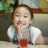 Chinese girl drink Stock Images